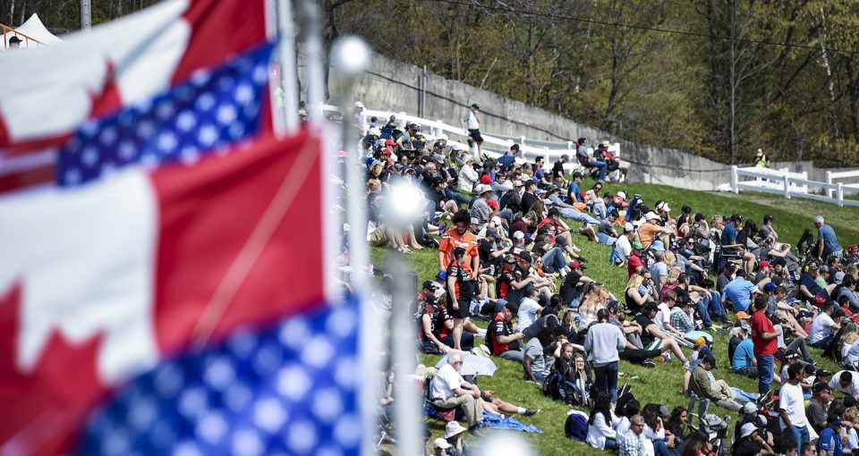 CLARINGTON, ON - MAY 19: Fans look out onto the front stretch and watch the race during the Clarington 200 of the NASCAR Pinty's Series at Canadian Tire Motorsports Park in Clarington, ON. (Photo by Matthew Manor for NASCAR)