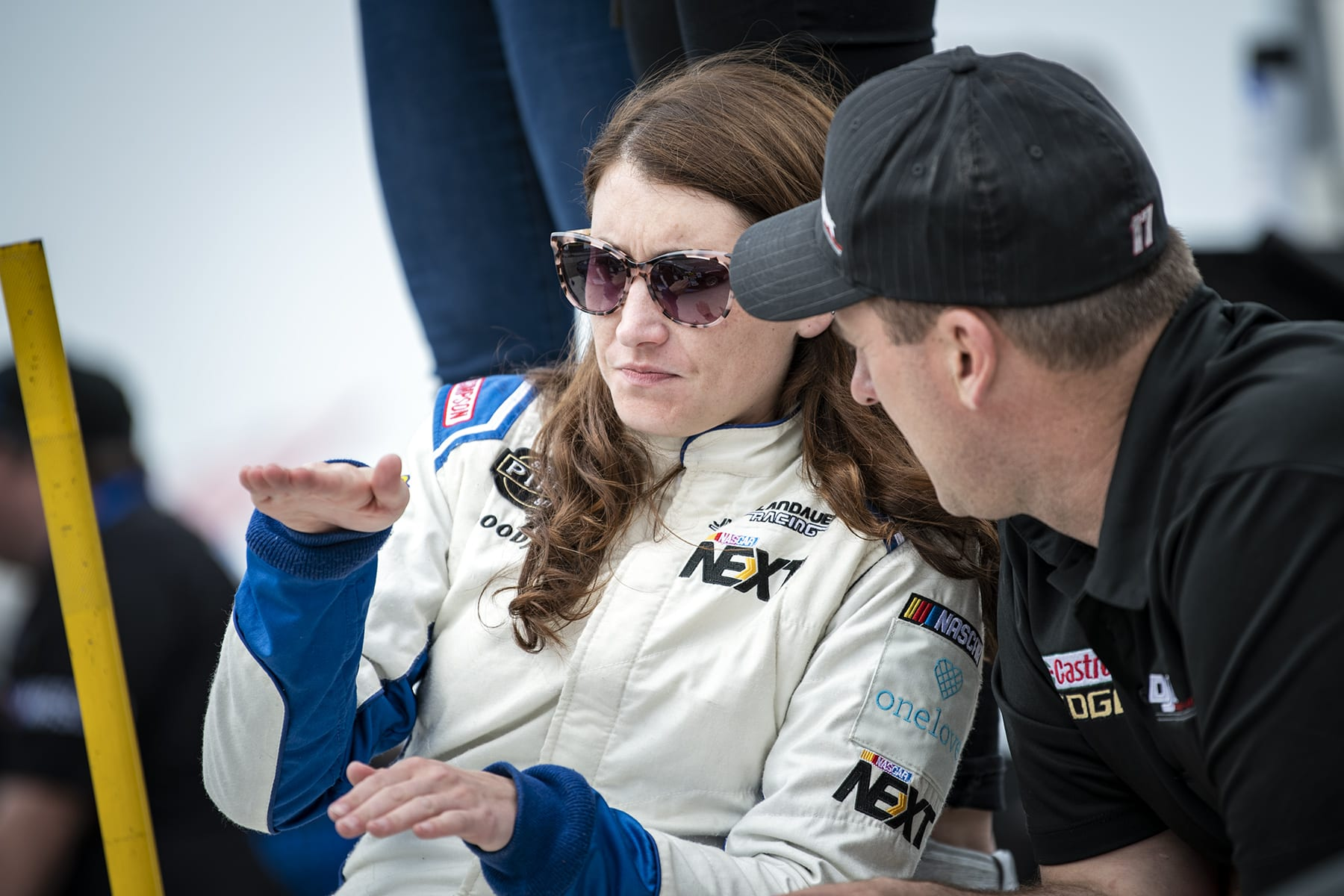 HAGERSVILLE, ON - JUNE 1: Julia Landauer, driver of the #28, One Love Foundation / TechForce Dodge talks tips and strategy with D.J. Kennington, driver of the #17, Castrol Edge Dodge prior to the practice session of the APC 200 of the NASCAR Pinty's Series at Jukasa Motor Speedway in Hagersville, ON. (Photo by Matthew Manor for NASCAR)
